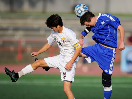 Memorial's Conor King (11) heads the ball past Chesterton's