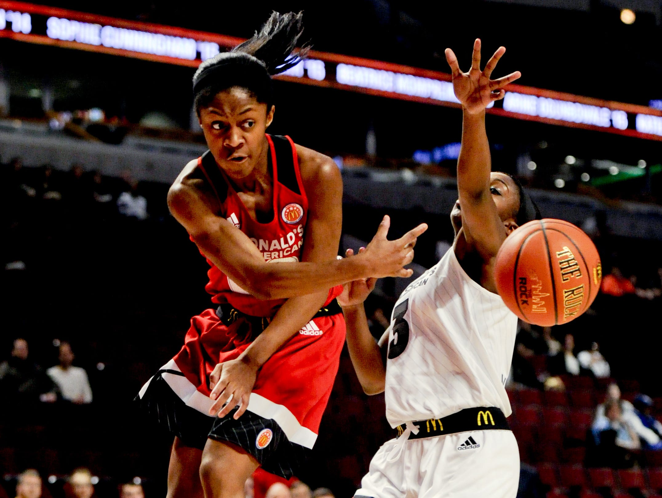 Blackman's Crystal Dangerfield, left, passes the ball in the McDonald's All-American Game on Wednesday in Chicago.