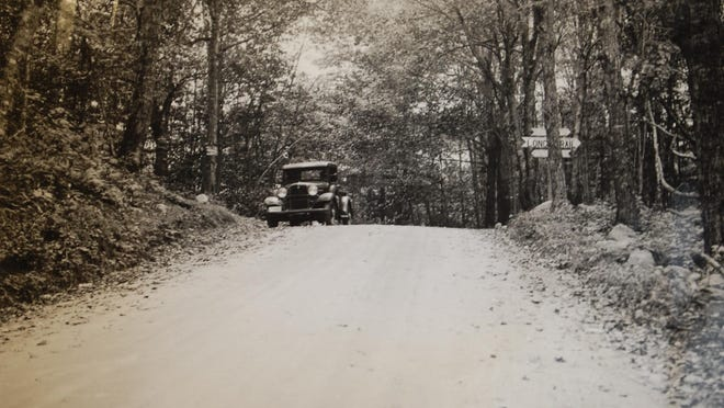 National Park Service survey truck at Brandon Gap in 1934. Parkway bridge would have been built over the Gap road.