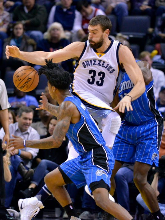 Memphis Grizzlies center Marc Gasol (33) struggles for control of the ball between Orlando Magic guard Elfrid Payton, left, and center Bismack Biyombo in the first half of an NBA basketball game Thursday, Dec. 1, 2016, in Memphis, Tenn. (AP Photo/Brandon Dill)
