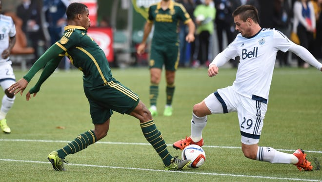 Portland Timbers defender Alvas Powell (2) goes after a ball with Vancouver Whitecaps forward Octavio Rivero (29) during the first half of an MLS western conference semifinal soccer match in Portland, Ore., Sunday, Nov. 1, 2015.