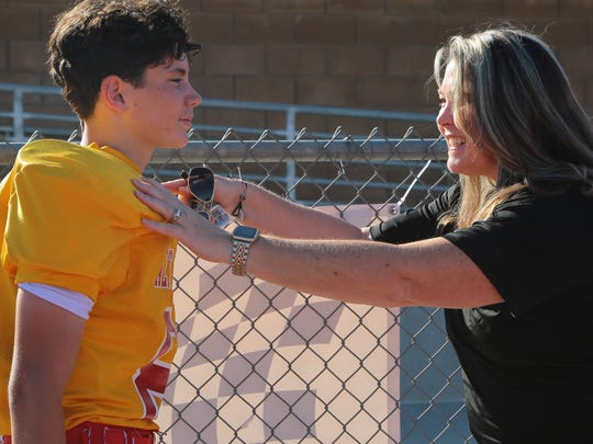 Samantha Buono gives her son Luca some encouragement before his game at Palm Desert High School, October 5, 2017.