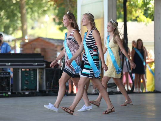 Fair queen contestants walk across the stage during the Iowa State Fair Queen Contest introductions at the Iowa State Fair on Thursday, Aug. 11, 2016, in Des Moines.