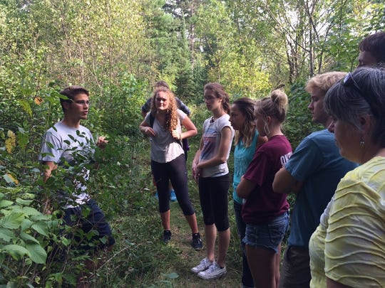 Student mentor Jesse Montoure, a natural resources major at UW-Stevens Point, led a nature walk at Treehaven – a break for first-year students who spent a week at Treehaven reviewing math skills.