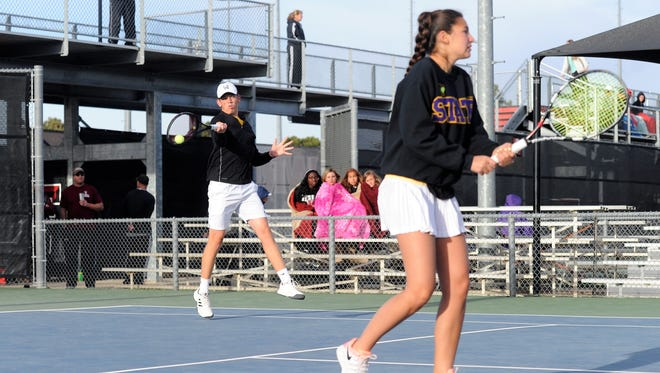 Wylie's Davyn Williford hits a shot behind mixed doubles partner Kaitlyn Hathorn during the Region I-4A final at Texas Tech's McLeod Tennis Center on Thursday, April 19, 2018. Williford and Hathorn finished off the tournament with a 6-2, 6-1 win for the championship.