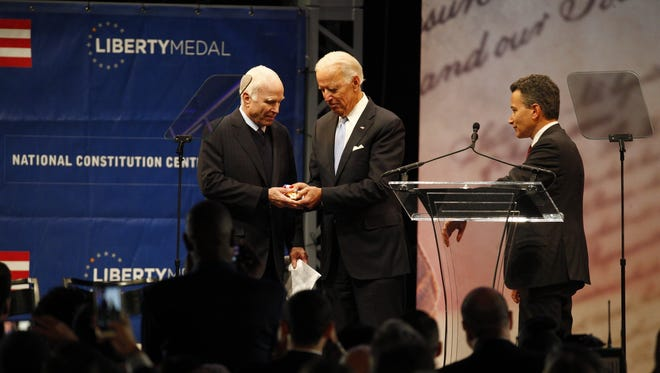 Former Vice President and chair of the National Constitution Center presents Sen. John McCain with the 2017 Liberty Medal Monday night at the National Constitution Center in Philadelphia.