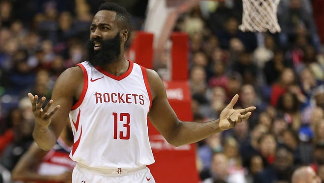 Houston Rockets guard James Harden (13) gestures on the court against the Washington Wizards in the third quarter at Capital One Arena.