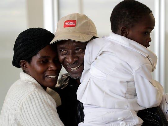 Charlotte Nyiranteguye and her daughter Neema hug Nyiranteguye's