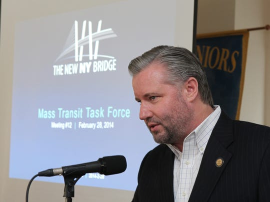 Thomas J. Madison, Jr., the executive director of the New York State Thruway Authority, opens the meeting of the Tappan Zee Mass Transit Task Force in Tarrytown Feb. 28, 2014.