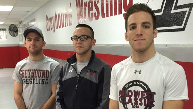From left, brothers Josh, Joe and Justin Kieffer. For the first time since high school, they were wrestling teammates this season at UIndy. Joe overcame leukemia before returning to the sport.