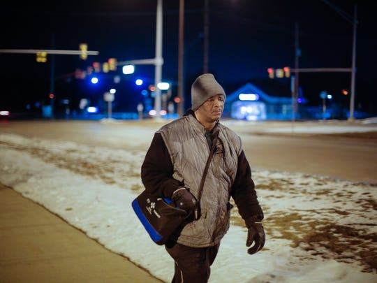 James Robertson, 56, of Detroit, makes his way along Crooks Rd after working his shift at Schain Mold & Engineering in Rochester Hills on Friday January 9, 2015.