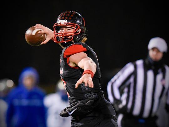 Rocori quarterback Jack Steil steps back to throw against