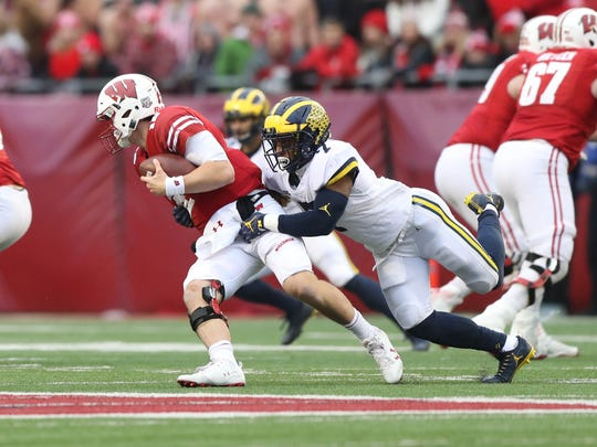 Michigan's Khaleke Hudson sacks Wisconsin's Alex Hornibrook during the fourth quarter Saturday, Nov. 18, 2017, at Camp Randall Stadium in Madison, Wis.