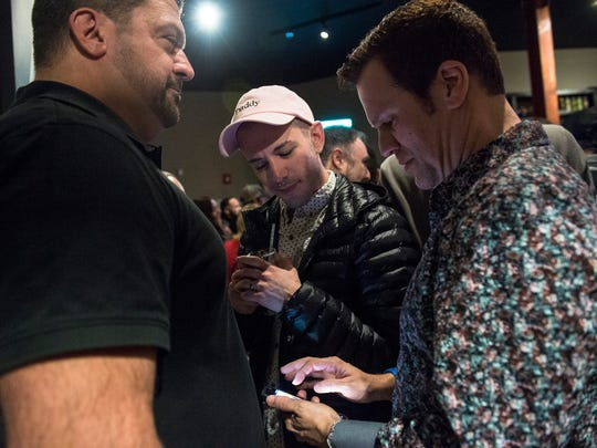 """From left, Ric Rackett of Springettsbury Township, Matt Higgins of York and Chris Schroeder of York gather at a monthly Guerrilla Gay Bar event Saturday, March 10, 2018, at Crystal Ball Brewing Co. in York. Every second Saturday, the Guerrilla Gay Bar group chooses a bar in York to """"take over"""" as a pop-up event to create a space for York's LGBTQ community to socialize and explore different parts of the city's bar scene."""