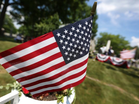 People come together for the 150th Observance of Memorial Day at Crown Hill National Cemetery.