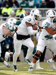 LJ Scott ran sparingly during Saturday's spring game. MSU already knows what it has in Scott, who is returning for his senior season rather than entering the NFL draft.
