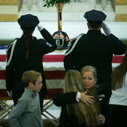 First responders salute the casket of Lt. Christopher