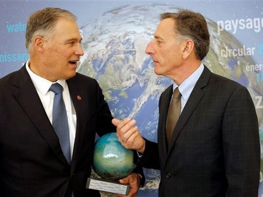 Gov. Peter Shumlin, right, speaks with Gov. Jay Inslee of Washington at the COP21 United Nations Climate Change Conference on Monday in Le Bourget, north of Paris. The Paris conference marked the 21st time world governments met to seek a joint solution to climate change.