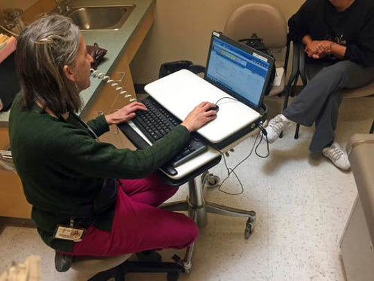In this Dec. 21, 2016 photo, family physician Leslie Hayes interviews a pregnant 40-year-old mother (right, obscured) being treated for an addiction to heroin with the anti-craving medication Subutex, at the El Centro Family Health medical clinic in Espanola, N.M. Hayes credits her ability to effectively treat opioid addiction disorders to a training and mentoring program known as Project ECHO that is being tapped by federal officials for possible broader applications.