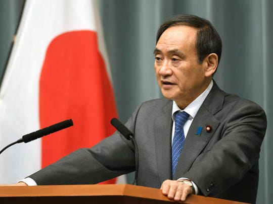 Japan's Chief Cabinet Secretary Yoshihide Suga speaks on a missile launch by North Korea at the prime minister's official residence in Tokyo Sunday, Feb. 12, 2017. North Korea reportedly fired a ballistic missile early Sunday in what would be its first such test of the year and an implicit challenge to President Donald Trump's new administration. The missile is believed to have splashed down into the sea between the Korean Peninsula and Japan. Suga told reporters the missile did not hit Japanese territorial seas.