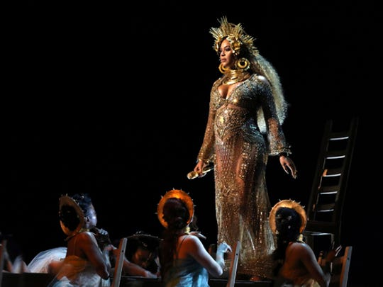 FILE - This Feb. 12, 2017 file photo shows Beyonce performing at the 59th annual Grammy Awards in Los Angeles. Beyonce, who is pregnant with twins, will not perform at Coachella this year, but will headline the festival in 2018. In a joint statement released Thursday, Feb. 23, Beyonce's Parkwood Entertainment and festival producer Goldenvoice said the pop star had to pull out of the famed festival under doctor's orders.