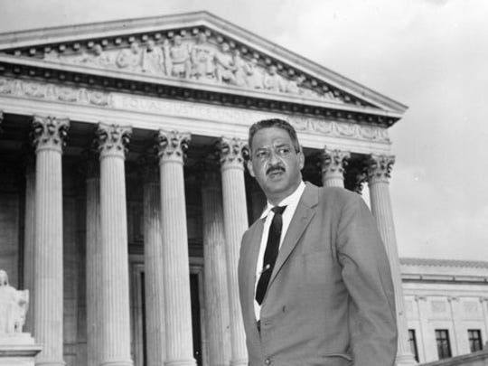 FILE - This Aug. 22, 1958 file photo shows Thurgood Marshall outside the Supreme Court in Washington. From the time Americans roll out of bed in the morning until they turn in, and even who they might be spending the night with, the court's rulings are woven into daily life in ways large and small.