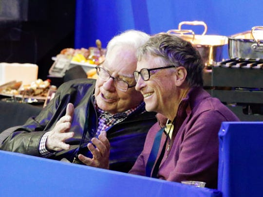 Bill Gates, right, and Warren Buffett talk during a break in the FEI World Cup equestrian jumping grand prix in Omaha, Neb., Saturday, April 1, 2017. Jennifer Gates, daughter of Bill Gates, is one of the contestants.