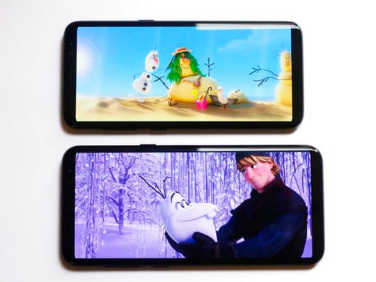 The Samsung Galaxy S8, top, and S8 Plus are displayed, Monday, April 17, 2017, in New York. The 5.8-inch S8 and the 6.2-inch S8 Plus both have nearly 15 percent more display space than last year's comparable models.