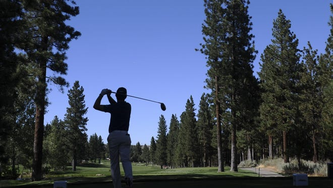 A golfer tees off during the second round of the Reno Tahoe Open at Montreux Golf Course on friday, August 2, 2013.