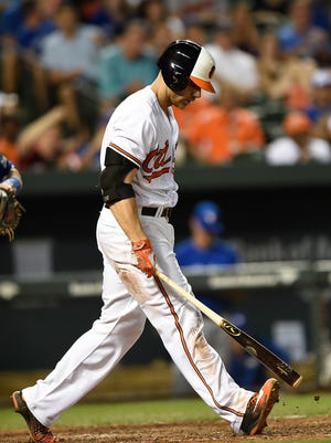Baltimore Orioles' Chris Davis reacts after striking out against the Toronto Blue Jays in the ninth inning of a baseball game, Monday, Aug. 29, 2016, in Baltimore. The Blue Jays won 5-1.