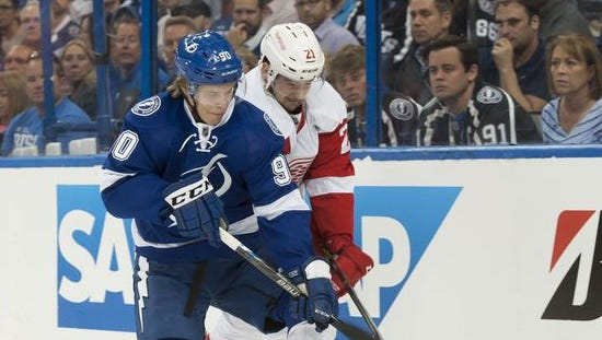 Tampa Bay center Vladislav Namestnikov and Detroit left wing Tomas Tatar battle for the puck in the first period.