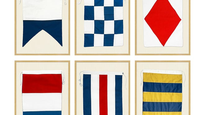 A subtle nod to nautical makes for delightful design. Made-to-order framed nautical flags, $199 each at potterybarn.com.
