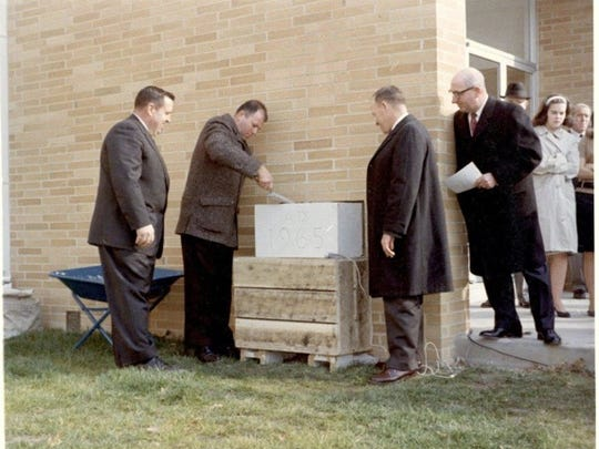 A photo from Courier-Post in 1965 of the time capsule being sealed in the wall of the school