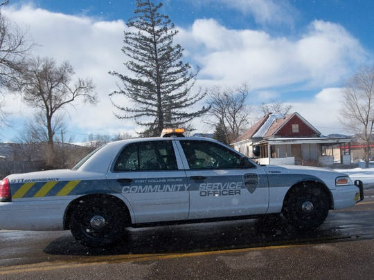 A Community Service Officer sits at the intersection of Taft Hill and Harmony Roads as high wind causes blowing snow Thursday, January 14, 2016. Blowing snow conditions caused road closures of Taft Hill Road and Shields Street south of Harmony Road.