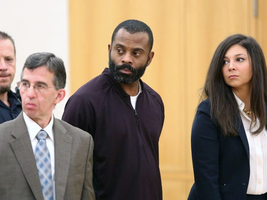 Neil White, center, with his attorney David Rich, left,