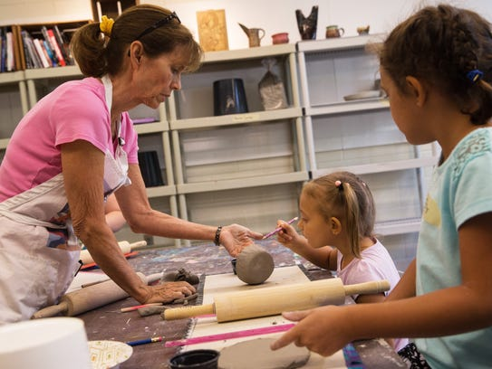 Instructor Kathy Anderson holds Corinne Lambotte's,