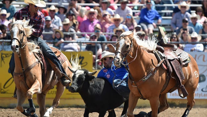 Tyler Pearson won the steer wrestling at the 2018 Red Bluff Round-Up. The Mississippi cowboy rode the horse Outlaw, right, who has carried the past four Round-Up steer wrestling champs to their wins.