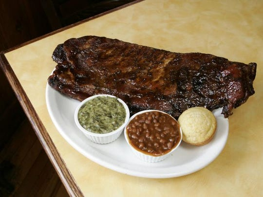 A plate of St. Louis Ribs with Creamed Spinach and