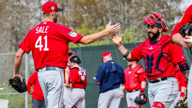 Chris Sale thanks catcher Sandy Leon for the morning workout. Red Sox Pitchers and catchers began practice at JetBlue Park, Fenway South, Tuesday morning. Former FGCU pitcher, Chris Sale, is now with the Red Sox and excited for the season.