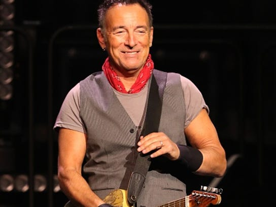 Bruce Springsteen and the E Street Band is seen performing
