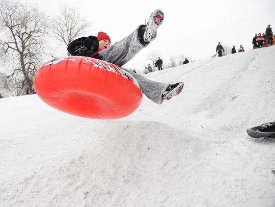 Donnie Massing enjoys tubing at Garfield Park in 2009.