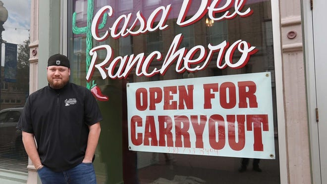 Danny Sanchez, co-owner of Casa Del Ranchero Mexican Restaurant, stands in front of his restaurant on West Tuscarawas Avenue Tuesday, May 12, 2020 in Barberton, Ohio. City officials will close the street starting on Friday so that restaurants and bars may have more outdoor seating for customers.