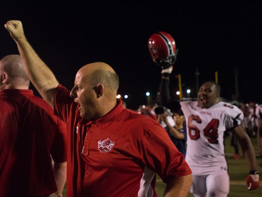 Central-Phenix City coach Jamey DuBose signals how many times he's lost to a Montgomery team in his career.