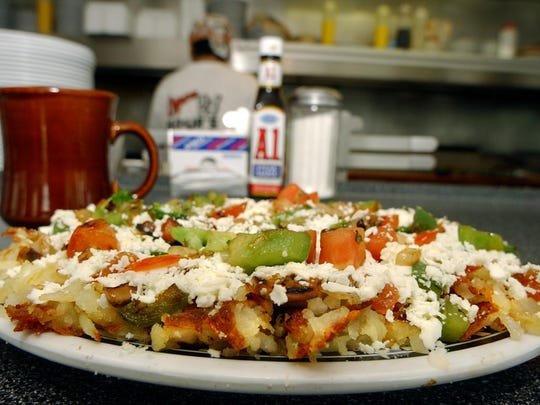 The signature breakfast at the Fleetwood Diner in Lansing is Hippie Hash, a plateful of homemade hash browns topped with grilled tomato, green pepper, mushrooms, onions, broccoli, and feta cheese, Aug. 24, 2005.