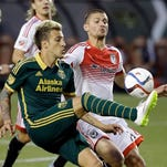 Portland Timbers forward Maximiliano Urruti, left, controls the ball against D.C. United midfielder Perry Kitchen during the second half of an MLS soccer game in Portland, Ore., Wednesday, May 27, 2015. Urruti scored Portland's lone goal as the Timbers won 1-0.