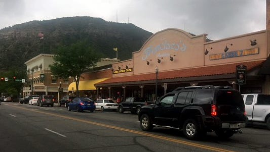 Traffic was light, as was foot traffic on usually-bustling Main Avenue at noon on Fathers Day 2018 in downtown Durango, Colorado, as light rain turned to welcome drizzle in the 416 Fire zone.