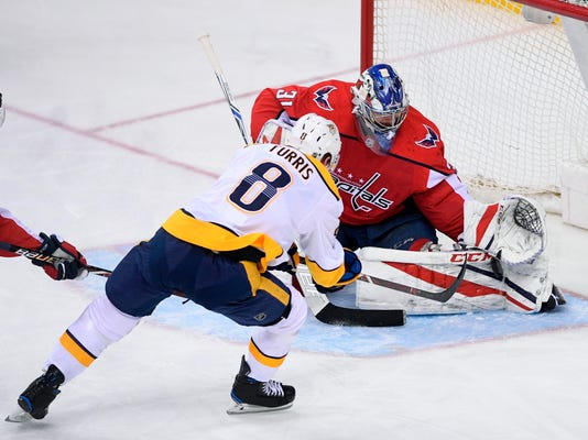 Washington Capitals goaltender Philipp Grubauer stops the puck against Nashville Predators center Kyle Turris (8) during the third period of an NHL hockey game Thursday, April 5, 2018, in Washington. The Predators won 4-3. (AP Photo/Nick Wass)