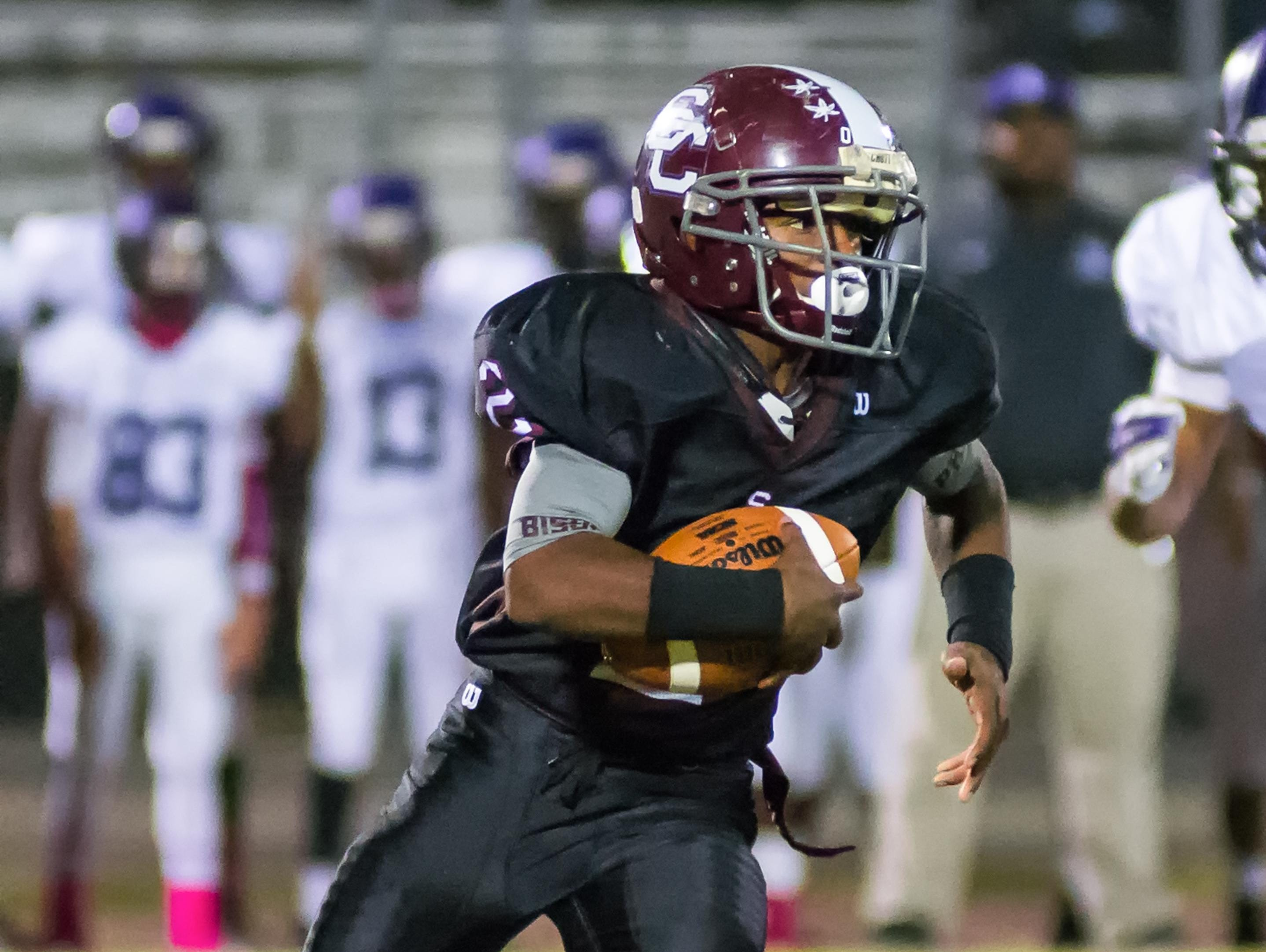 Station Camp High sophomore running back Kaemon Dunlap carries the football around the right end.