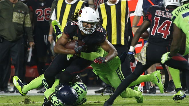 Cardinals' Larry Fitzgerald (11) pulls forward against Seahawks' Shaquill Griffin (26) and Justin Coleman (28) during the third quarter on Nov. 9, 2017 at University of Phoenix Stadium in Glendale, Ariz.