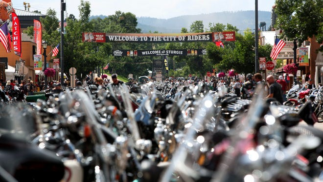 In this Aug. 1, 2014 file photo, the city streets of Sturgis are lined with motorcycles days before the official kickoff of the annual Sturgis Motorcycle Rally in Sturgis, S.D. Preparations are under way for the landmark 75th anniversary rally beginning Monday, Aug. 3, 2015, where organizers are planning for up to one million people.